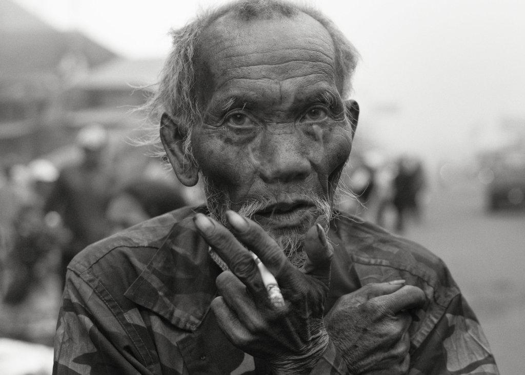 Bali mountain market  Smoking man